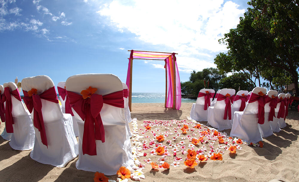 Hawaii beach weddings custom designed alters on oahu dark pink magenta sash with orange and pink and yellow hawaiian flowers junglespirit Choice Image