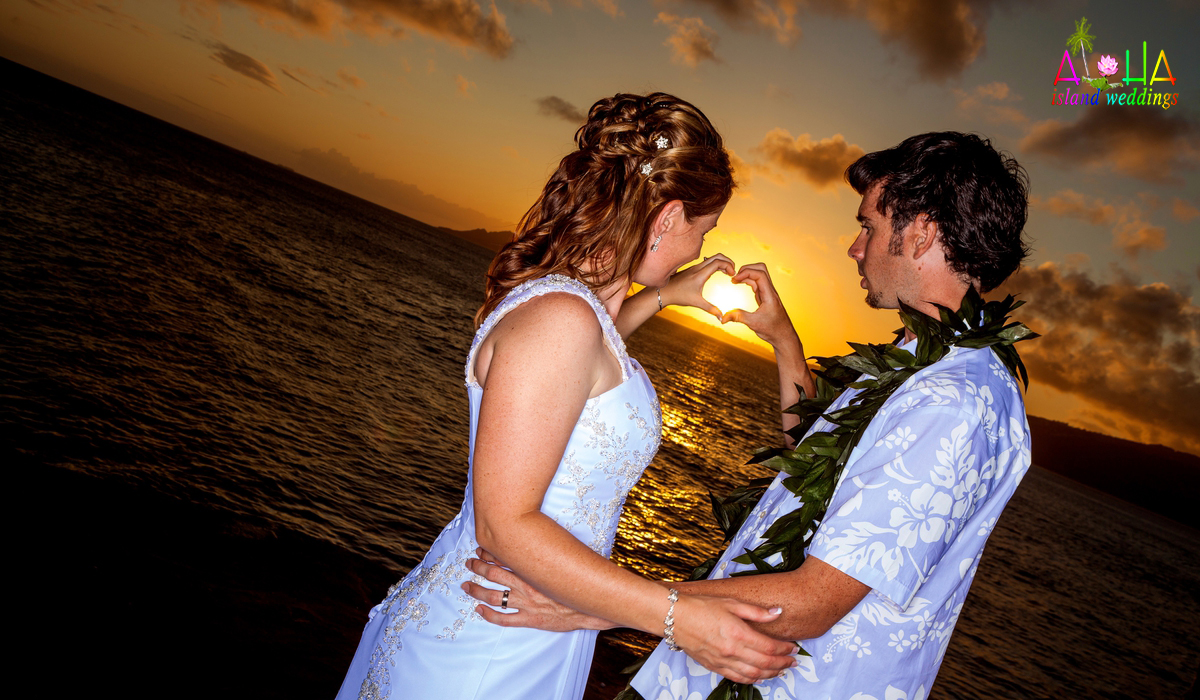 sunset in Hawaii after their wedding making a heart