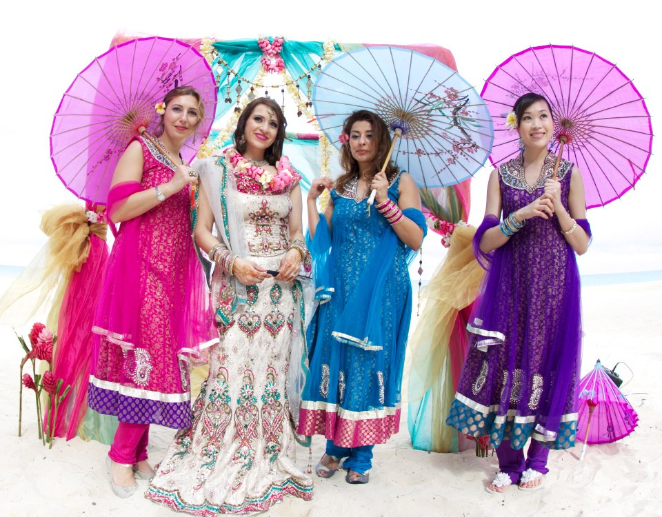 Indian wedding ceremony on Oahu with her bridesmaids and umbrella