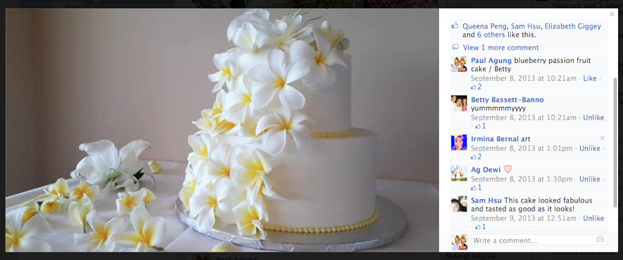 delicate white plumerias casqueding down the cake