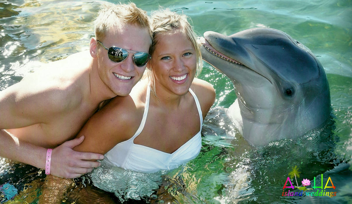our wedding couple with a dolphin