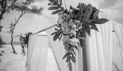 black and white beach wedding in Hawaii closup of the arch