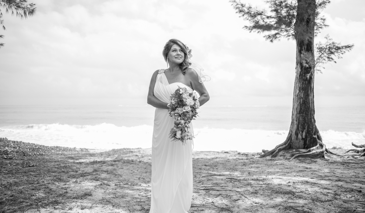 the bride in black nd white beach wedding in Hawaii