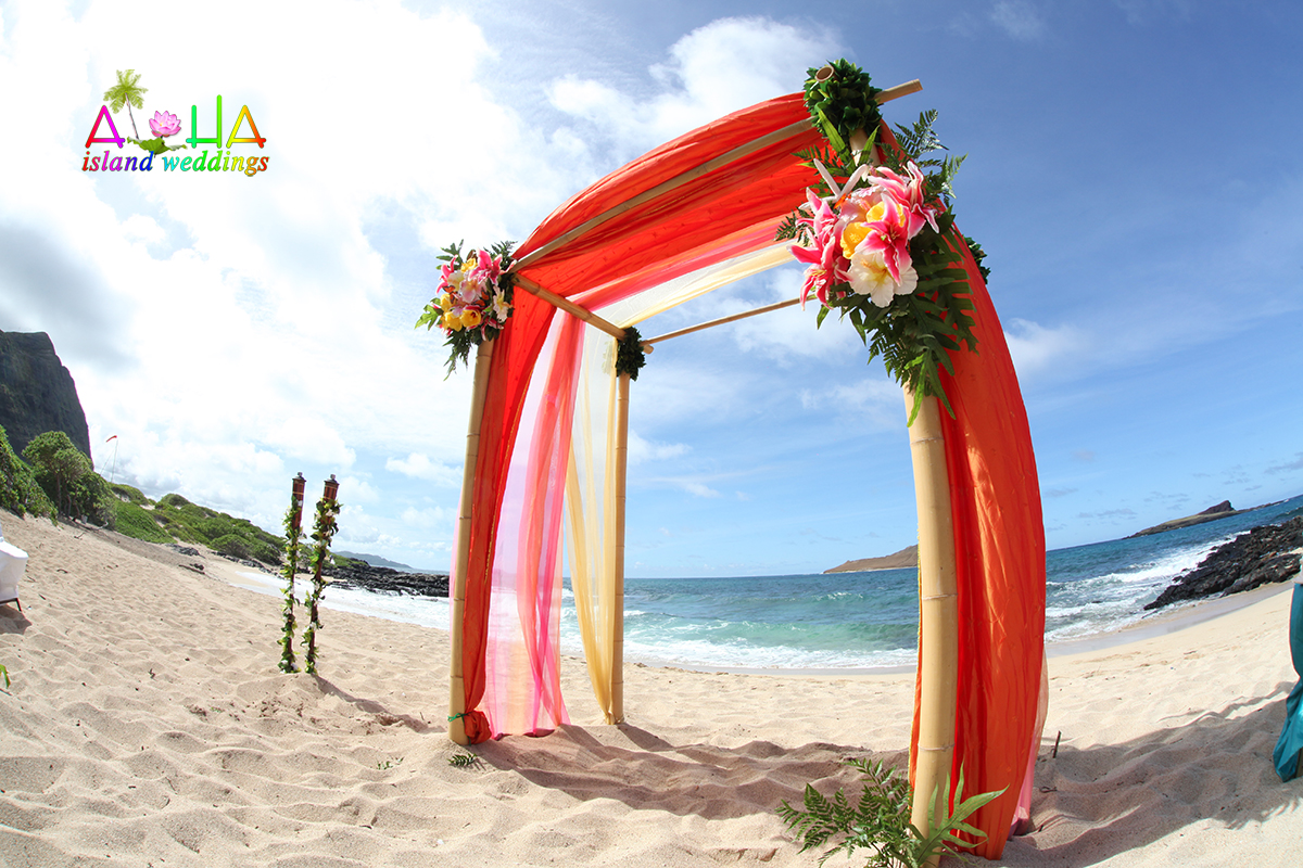 Makapuu beach wedding with yellow light pink and orange/red color design