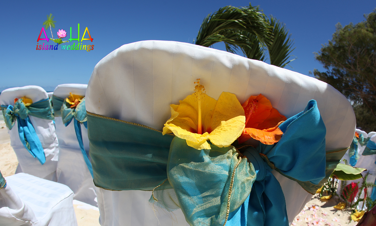 palm arch with acean blue and misty turquoise sash on white chair beach cover