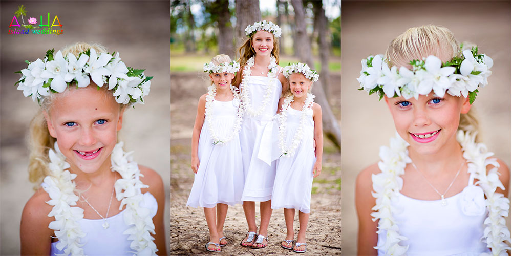 children with white flower Hawaiian haku flower leis at wedding on beach in Waimanalo