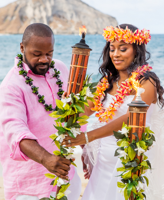 lighting the tiki fire torch unity of love on the beach wedding