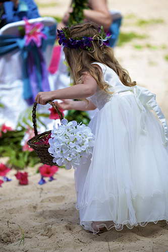 adding flowers to the pathway for her mom to walk down the aisle too