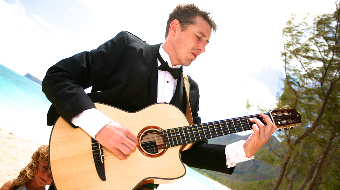 the bestman plays the guitar for his sister who is the Hawaii bride