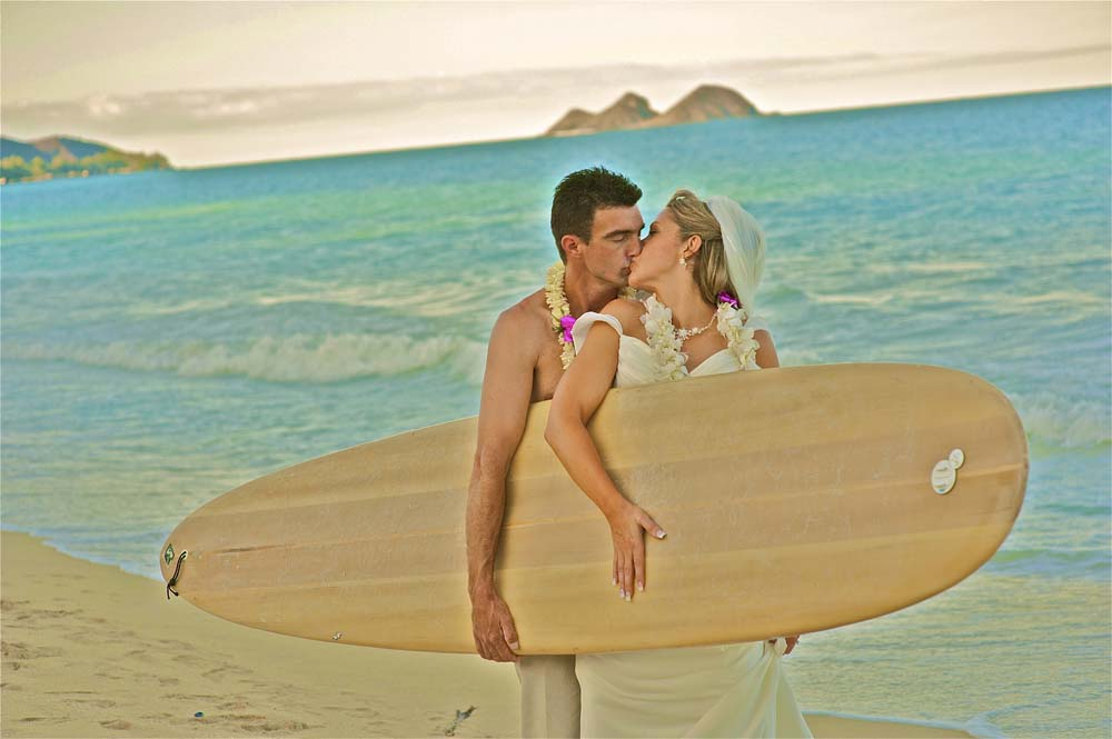 holding surfboard after the wedding with Leigh and troy