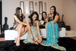 after Henna the bride shows off her feet to her friends