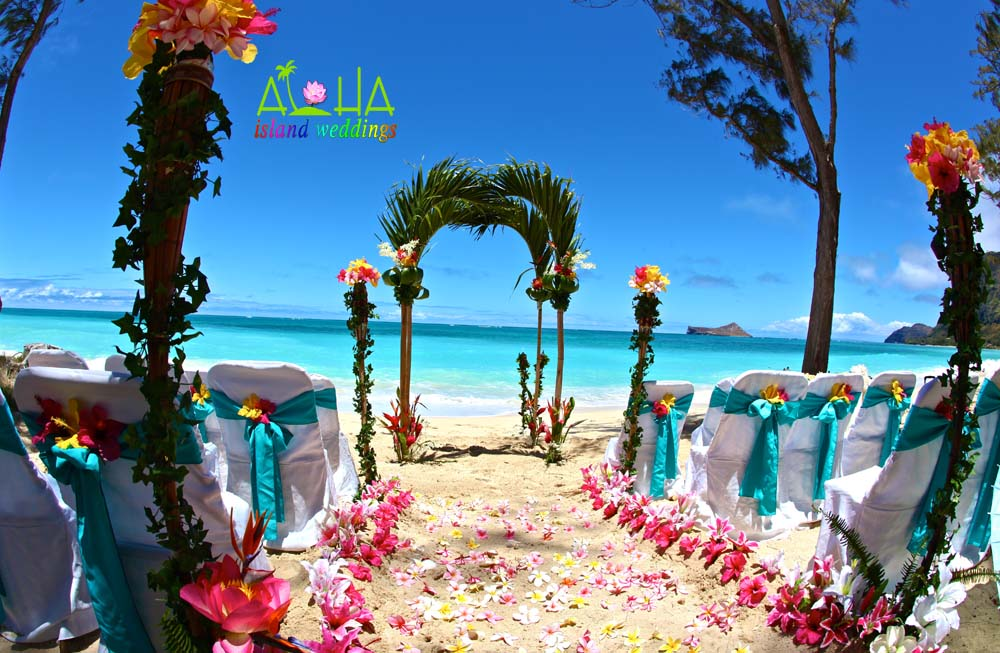palm arch for a beach wedding in Hawaii with tiki torches and hawaiian tropical flowers