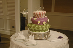 the mad hatter style wedding cake shown at the kahal resort at a reception of Aloha Island Weddings