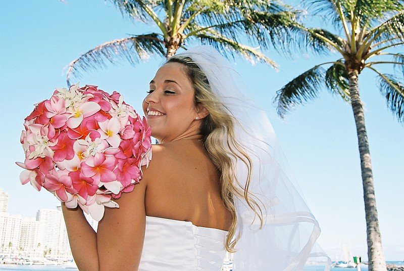 Multi color pink plumeria bouquet at magic island in Honolulu Waikiki for a bride