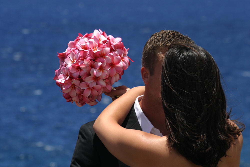 beautiful light and dark pink plumeria bouquet with the bride on Oahu
