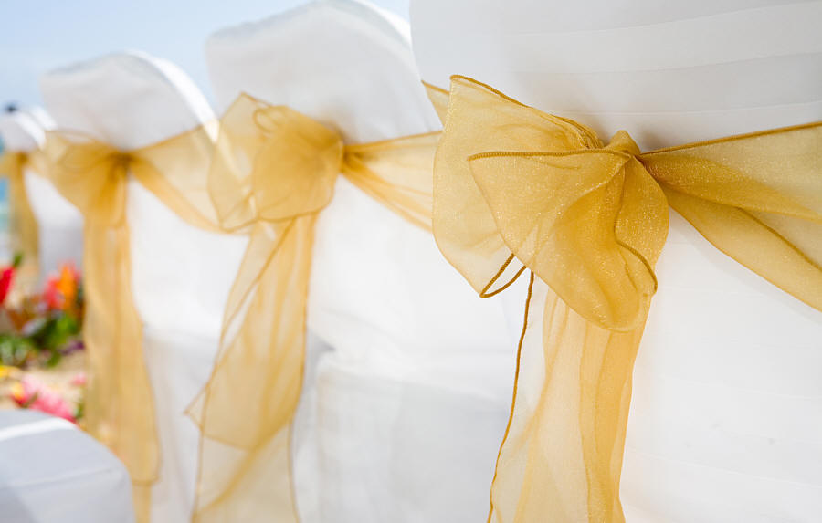 golden organza see through sash on a beach chair in Hawaii