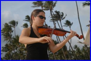 violinist at a wedding in Hawaii playing the bridal march