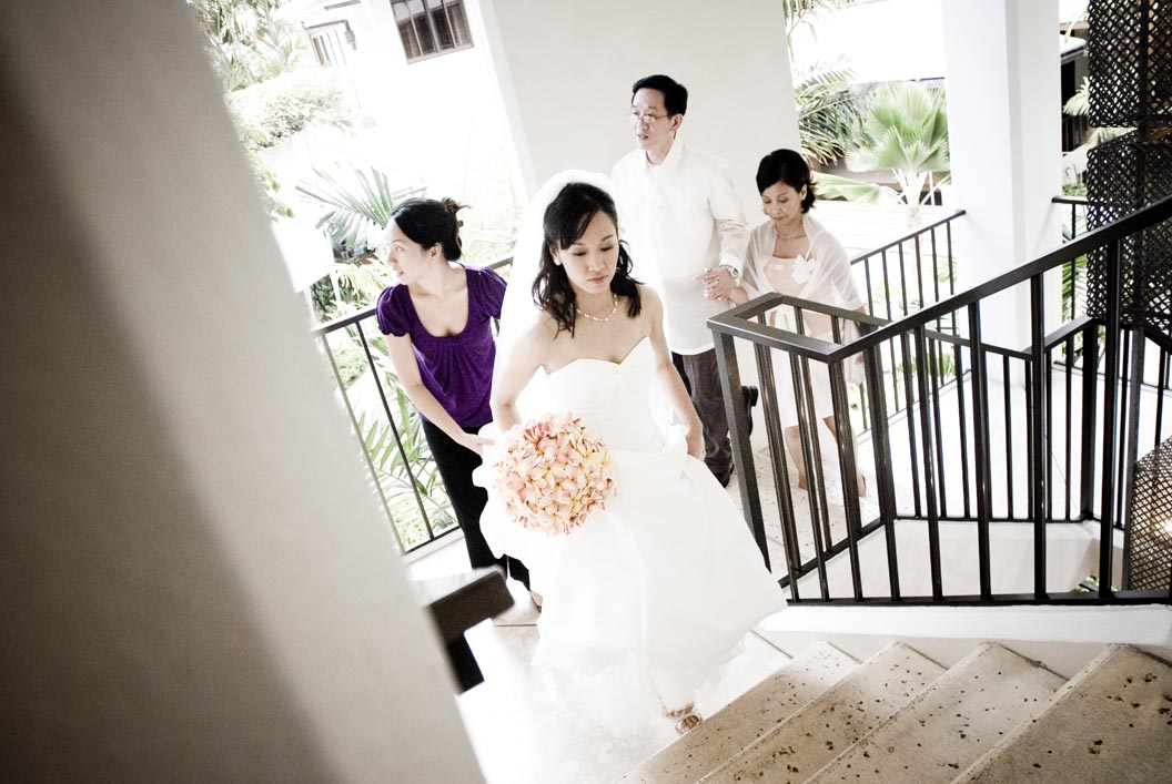 the hawaii bride walkign up the stairs