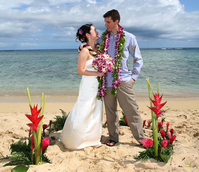 http://www.alohaislandweddings.com/images/looking%20at%20each%20other%20in%20the%20%20hawaiian%20flower3.jpg