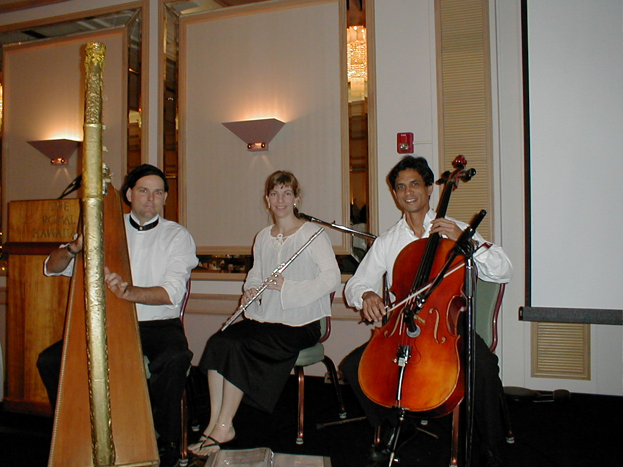 a string trio playing at the royal Hawaiian hotel