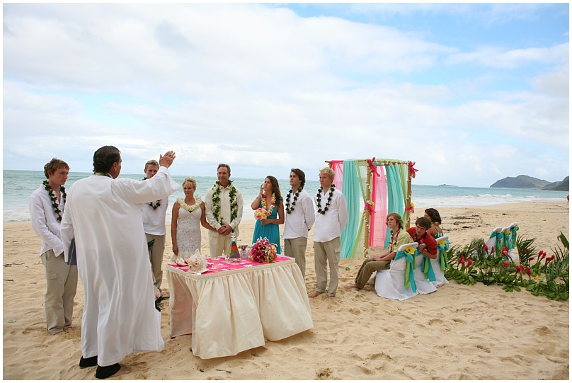 minister from Hawaii Alan Fisher lifting his hand to say a bllessing for the ten year vow renewal