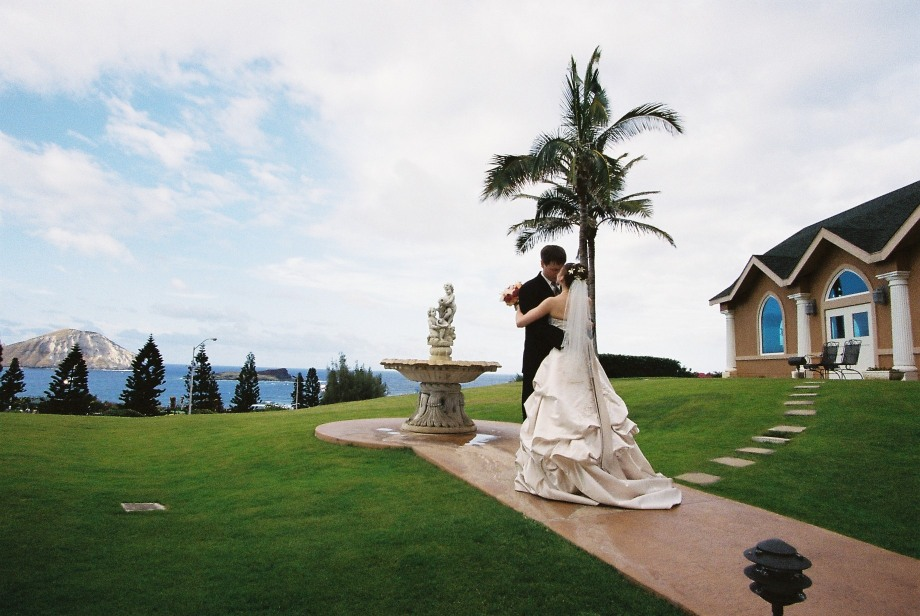 Karen dancing at her Hawaii church wedding over looking the ocean