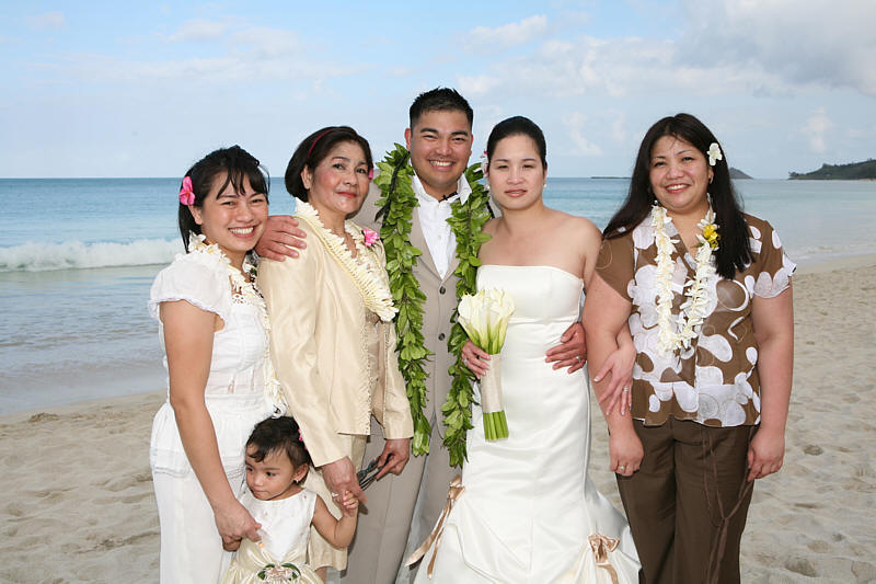 Wedding after their beach ceremony with mom and family