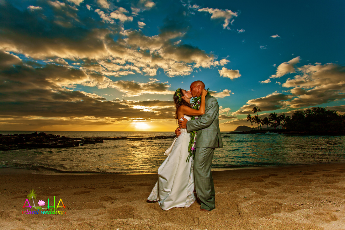 grabing eachothers but after wedding at paradise cove luau sunset