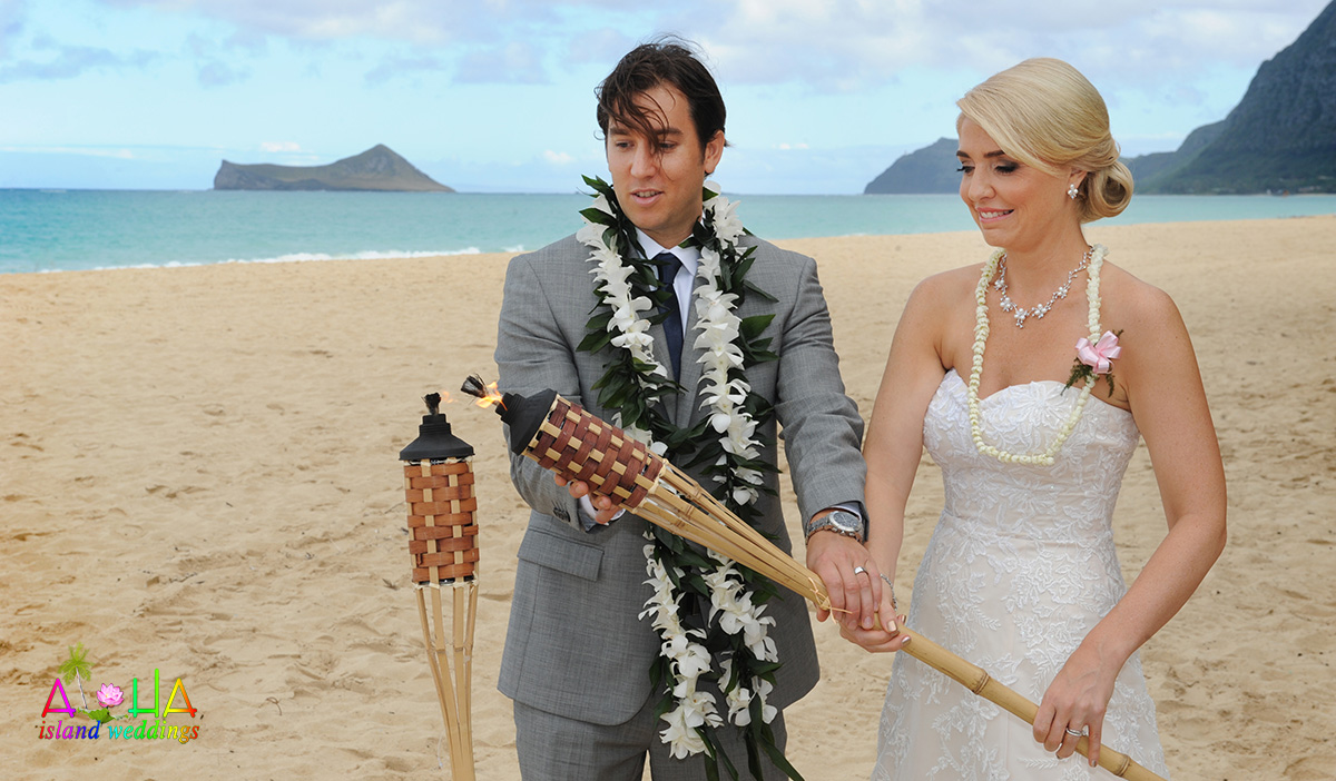 fire torch lighting on beach wedding cermeony