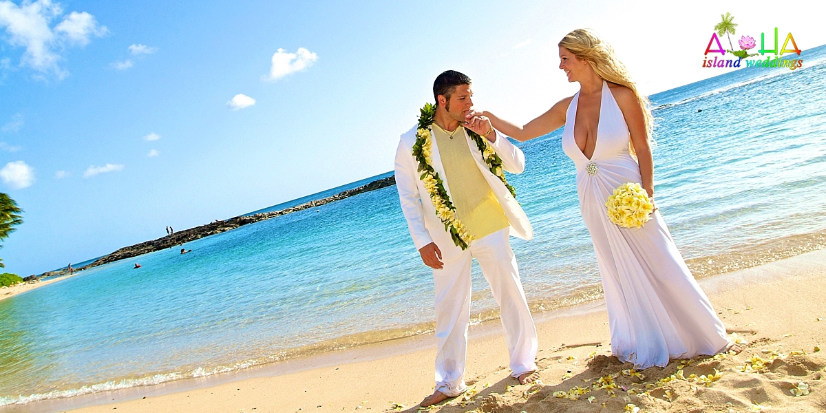 Hawaii Gallery For Beach Weddings Kissing Her Hand With Yellow Plumeria Bouquet