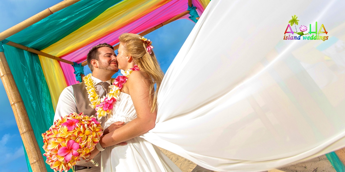 bride and groom smiling and loving eachother on their Oahu wedding