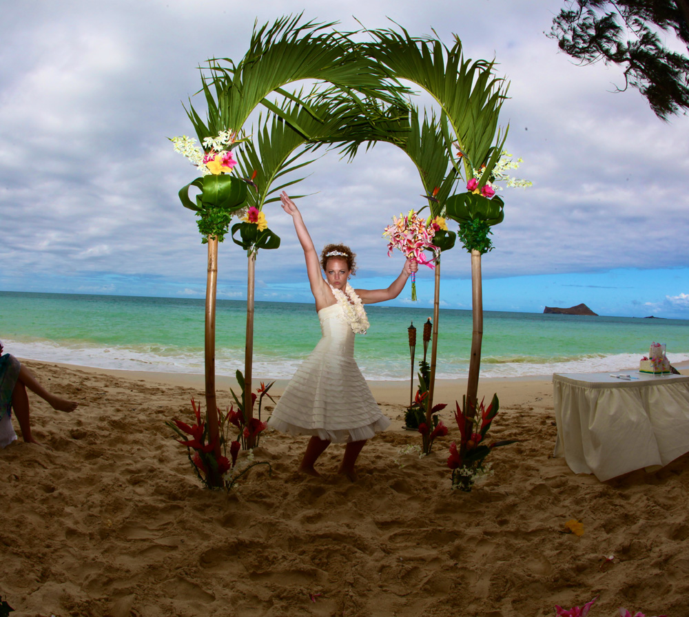 My wedding fun photo under the green bamboo palm arch at Waimanalo Beach park