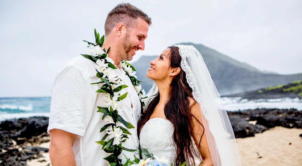 looking at eachother after their Hawaii beach wedding