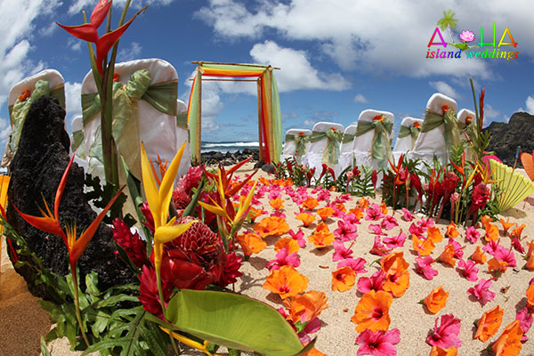 wedding theme orange and pink for beach ceremony