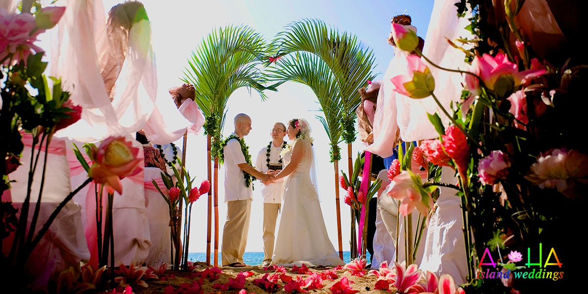 Beach Wedding Ceremony Oahu: Palm Arch With Lotus Flowers At Paradise Cove Hawaii