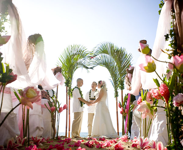lotus flowers with beach wedding archway