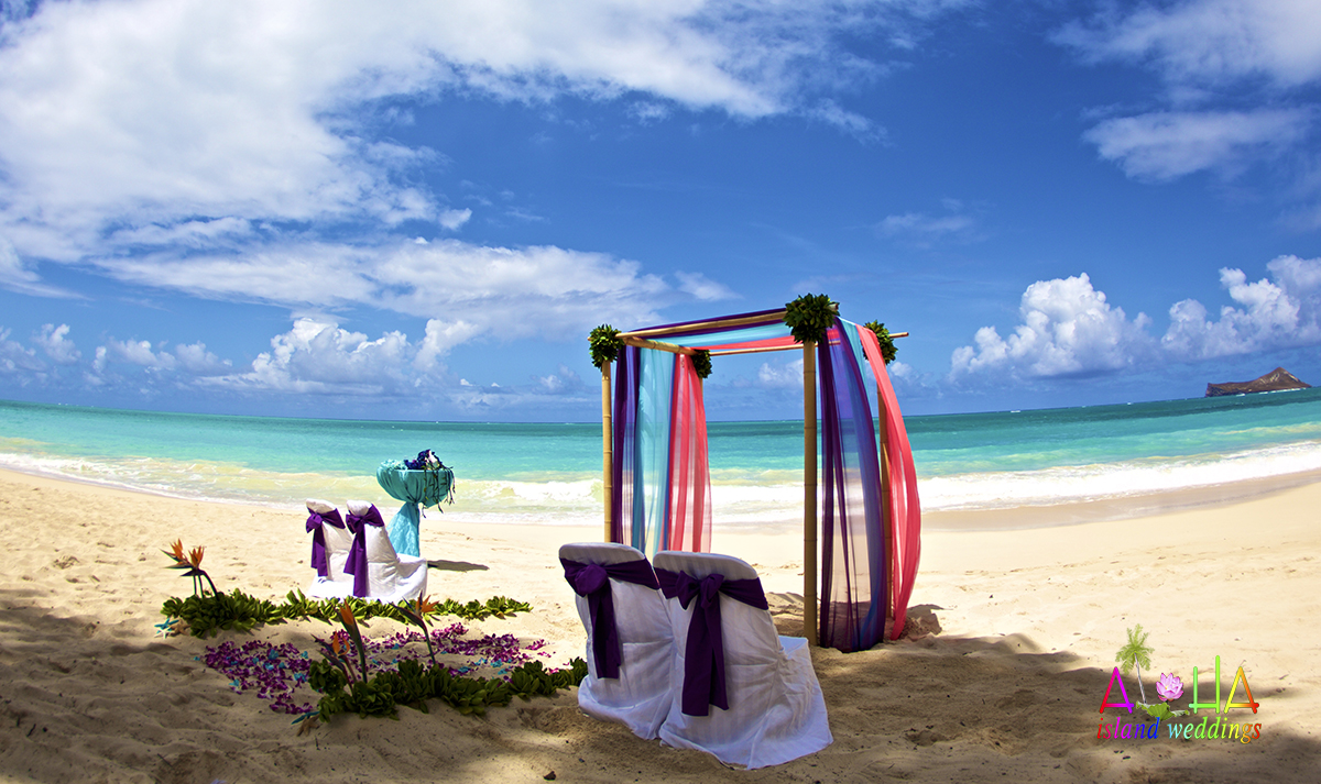 purple and blue themed wedding in Hawaii on the sand ceremony