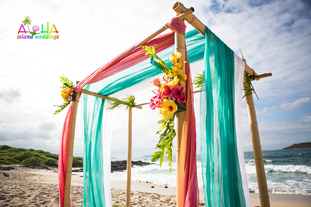 Green Ranbow pink and silvery white on the Oahu beach bamboo arch in the afternoon with flowers