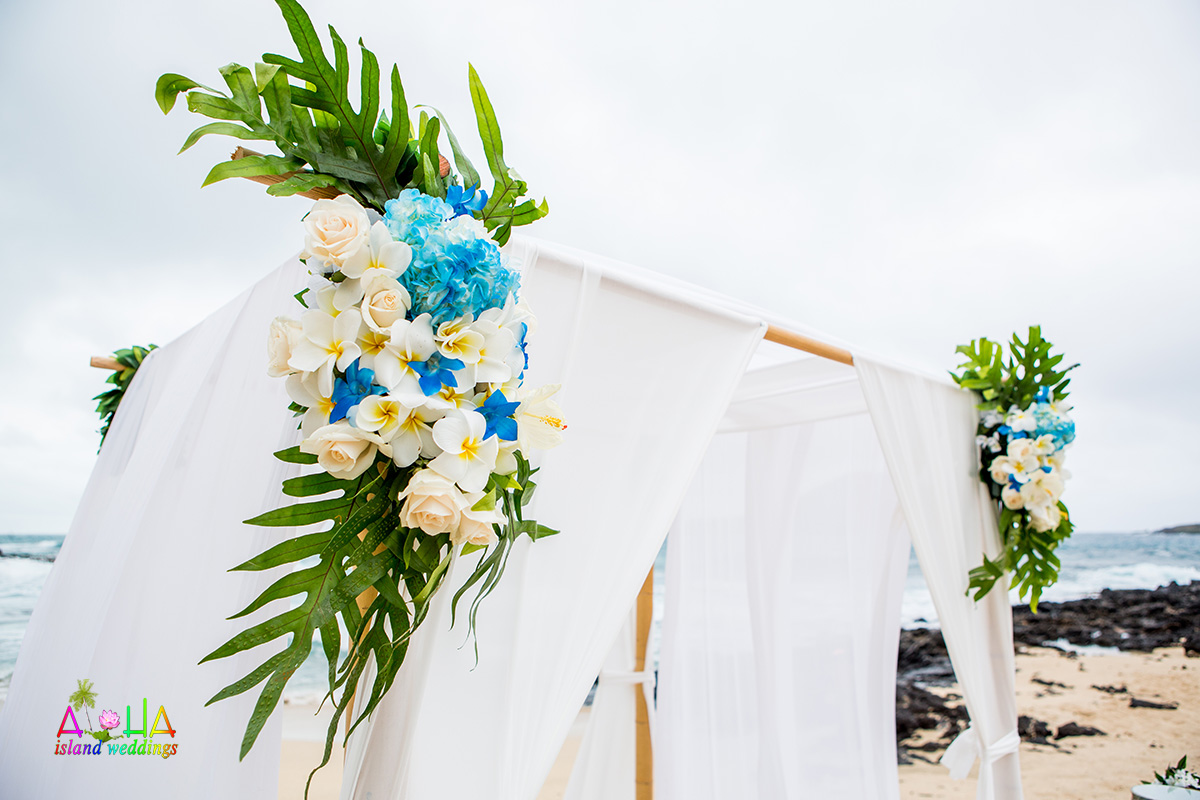 accents of blue and white and yellow on beach arch
