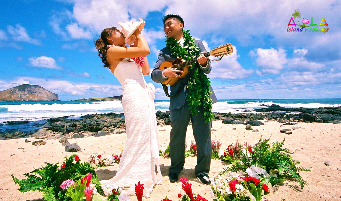 flower circle groom playing the ukulele and bride blowing the conch shell