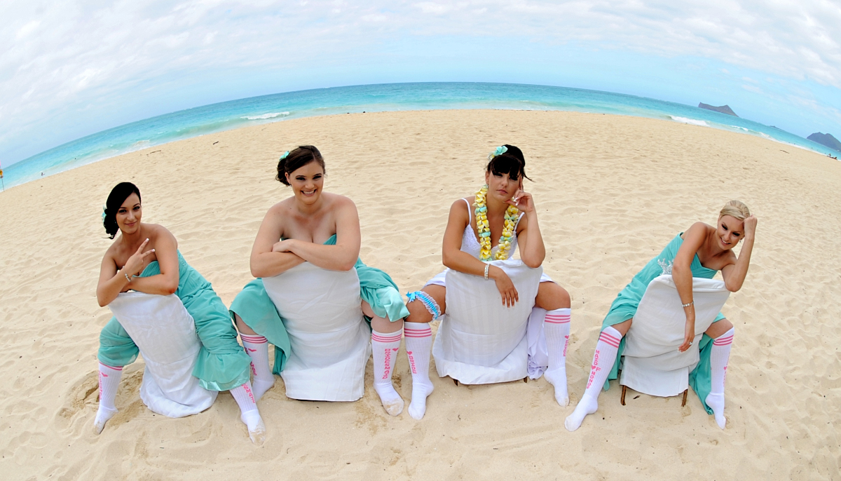 waiting for the groomsmen on the beach hanging out looking bored