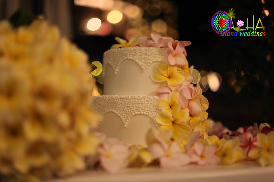 Cake for a wedding in Hawaii with yellow and light pink plumerias