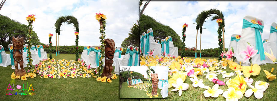palms arch with tiki wooden Hawaiian statues at estate house wedding pink and yellow flowers