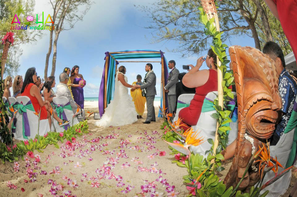 Wedding ceremony couple by the bamboo alter on the beach Riini and Terry