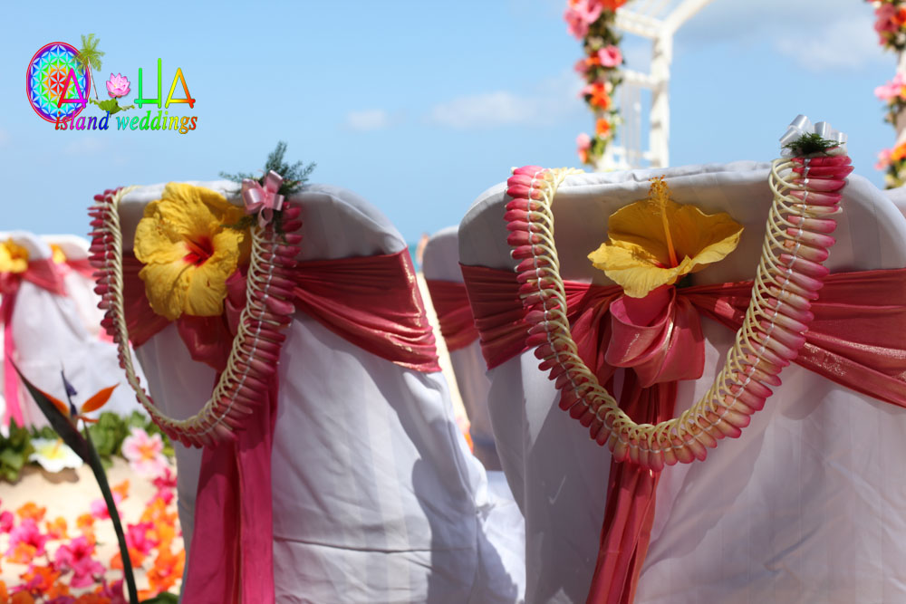 flowers in your hair and on your neck with pink and white micronesian lei