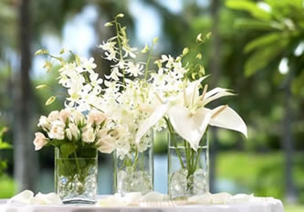 white roses anthuriums and orchids spray