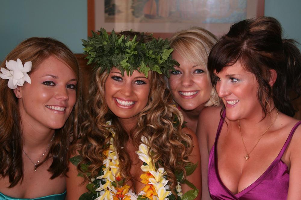 The bride wearing a Hawaiian head lei before her beach wedding in Hawaii