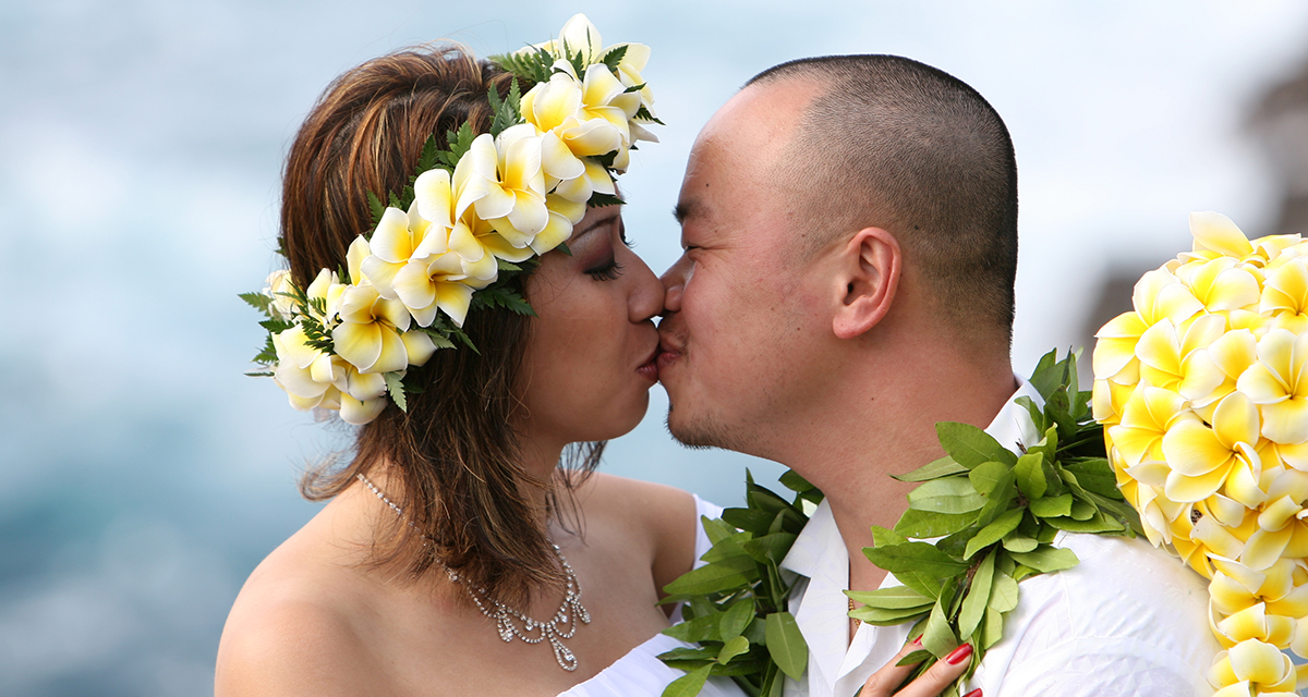 Kissing Her Husband With A Yellow Plumeria Haku Lei